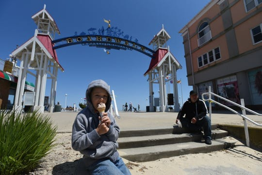 Kaleb Rodgers, 7, of Bridgeville, Delaware, eats an ice cream cone near the Boardwalk in Ocean City Sunday, May 10, 2020.