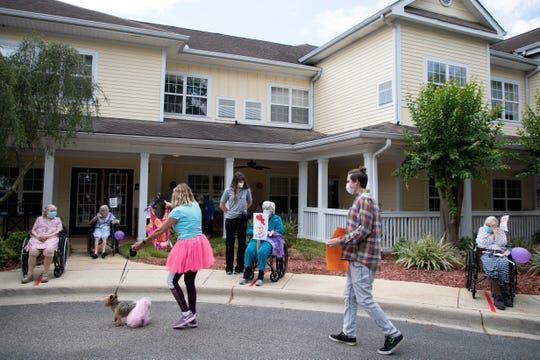 Family members and loved ones of mothers living at Harbor Chase retirement home and memory care center paraded in front of the facility to celebrate Mother's Day Sunday, May 10, 2020.