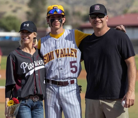 Royal High senior Chase Aurand, with his mother Lora, left, and father Christian, was hitting .438 through eight games before the high school baseball season was shut down.