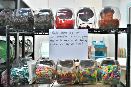 Visalia's Candy Cottage stopped offering self-serve for bulk items to prevent cross-contamination after reopening Thursday.