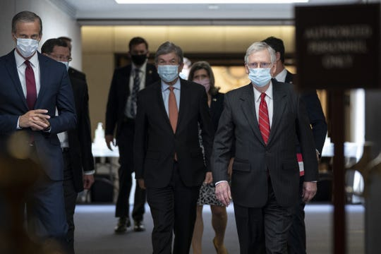 (L-R) Sen. John Thune (R-SD), Sen. Roy Blunt (R-MO) and Senate Majority Leader Mitch McConnell (R-KY) leave a Senate Republican policy luncheon in the Hart Senate Office Building on May 5.