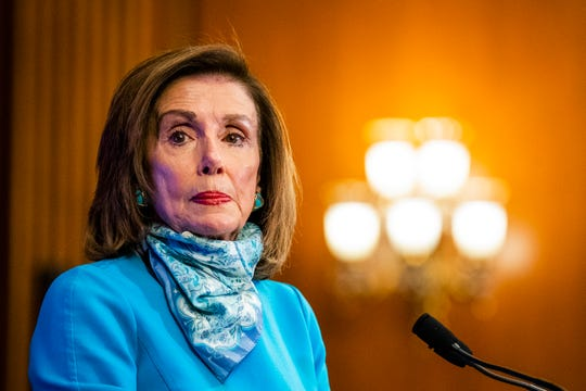 House Speaker Nancy Pelosi of Calif., listens to a reporter's question during a news conference on Capitol Hill on May 7.