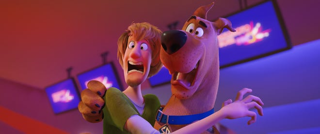 "Shaggy (left, voiced by Will Forte) and Scooby-Doo (Frank Welker) are up to their scaredy-cat high jinks again in ""Scoob!"""
