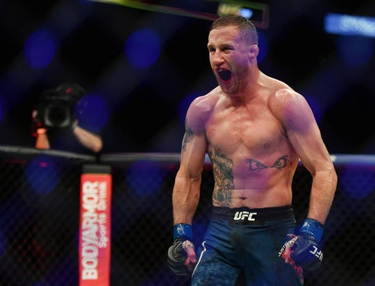 Justin Gaethje celebrates after defeating Tony Ferguson during UFC 249 at VyStar Veterans Memorial Arena.