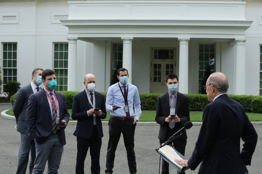 WASHINGTON, DC - MAY 08: White House Economic Council Director Larry Kudlow talks to reporters wearing face masks outside the White House on the morning that the Labor Department announced that more than 20 million people lost their jobs in April due to the novel coronavirus pandemic May 08, 2020 in Washington, DC. ""