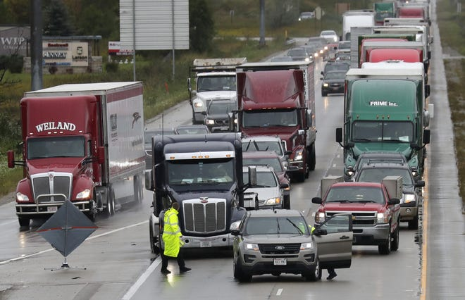 Police close southbound Interstate 41 at Ballard Road following a crash in September.