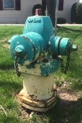 Appleton spends $16,000 annually to repaint its fire hydrants. This one eventually will be repainted all green, indicating a flow rate of 1,000 to 1,499 gallons per minute.