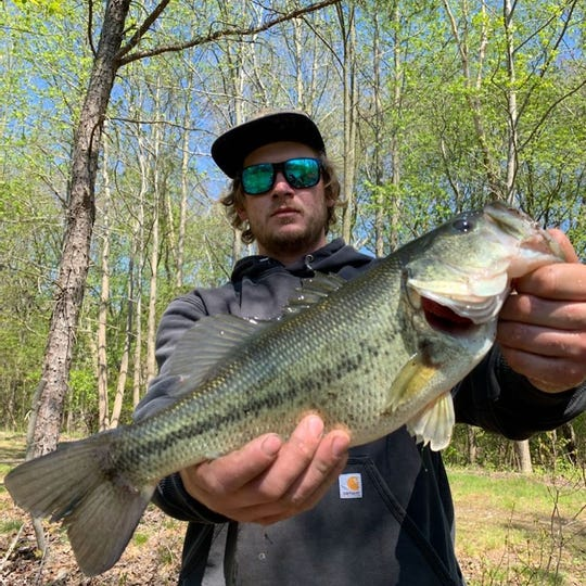Chris Steinert with a freshwater bass taken Mother's Day weekend.