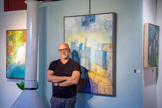 Artist Mark Bettis poses at his studio in the River Arts District on May 7, 2020. Bettis is creating new work every day for the artists support pledge and has already purchased at least six pieces to help support his fellow creators.