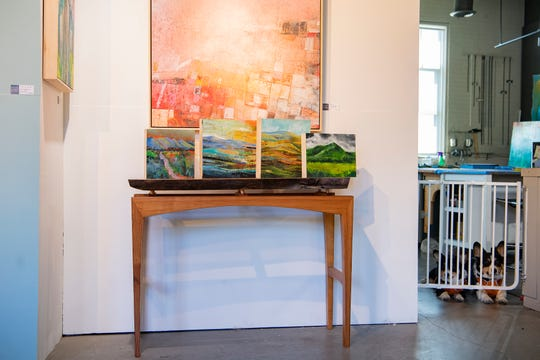 With his corgis, Lucca and Chunk, keeping watch, Mark Bettis' pieces being sold for the artist support pledge, along with more of his and other artists' work, are on display in his studio in the River Arts District on May 7, 2020. Artists participating in the pledge are selling art for $200 or less and then using some of their profits to support other artists by buying their pieces.