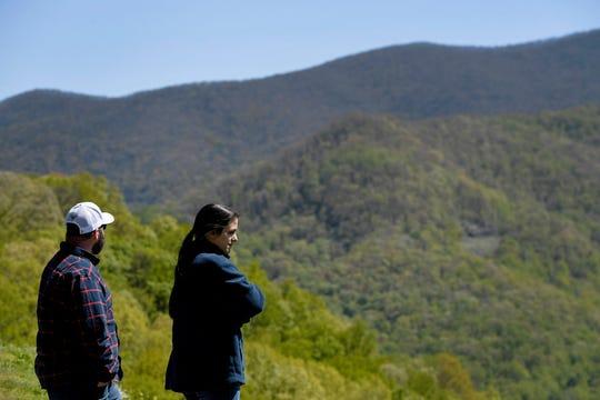 Diana Andrews and Joey Truett, of South Carolina, take in the view along the Blue Ridge Parkway at the Tanbark Ridge Overlook May 9, 2020.