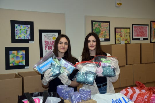 Alessia Stead, left, and her twin sister, Madison, Co-presidents of the Girl Up Club at Union-Endicott High School,  organized a drive to help students during the COVID-19 pandemic.