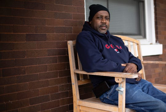 Ted Richardson poses on the porch of his home in the Evanston neighborhood of Cincinnati on Monday, May 11, 2020. Richardson is at home and feeling well after being released from Christ Hospital where he was treated for COVID-19. Richardson's condition improved after he underwent experimental treatment using convalescent plasma.