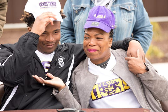 Roger Bacon running back Corey Kiner embraces his mother, Denean, after announcing that he has committed to play football at LSU at a press conference at Bron Bacevich Stadium in North Avondale on Monday, May 11, 2020.