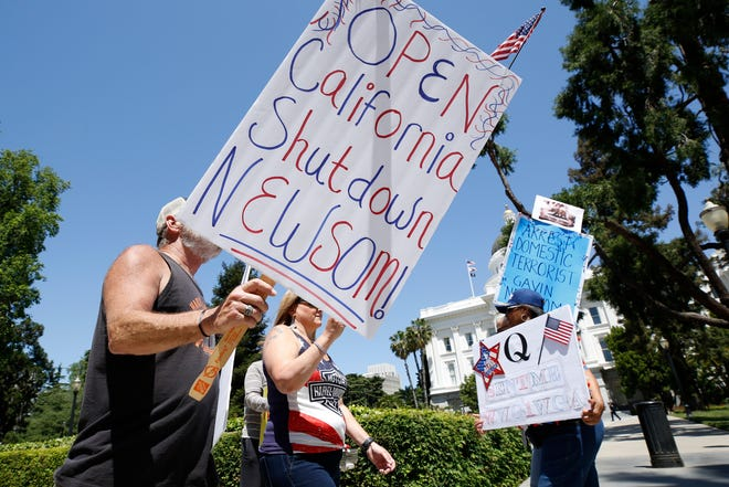 May 1, 2020: Protesters calling for the end of Gov. Gavin Newsom's stay-at-home orders march around the state Capitol in Sacramento, Calif.