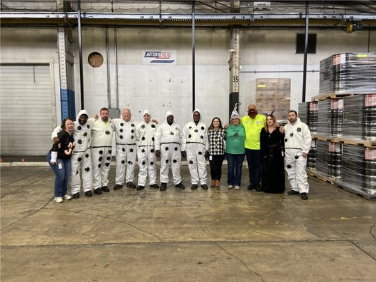 Team members at Kost USA showing off their best costumes for Halloween.