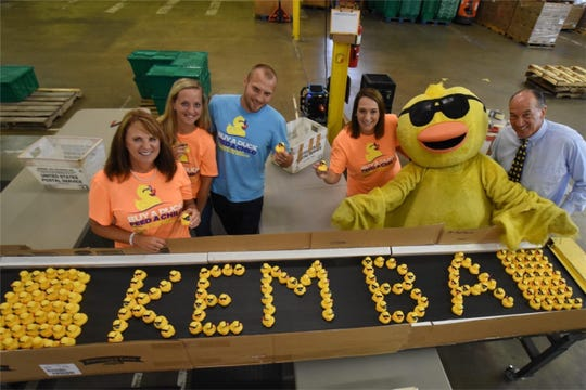 Kemba employees volunteer for the Freestore Foodbank Rubber Duck Regatta.