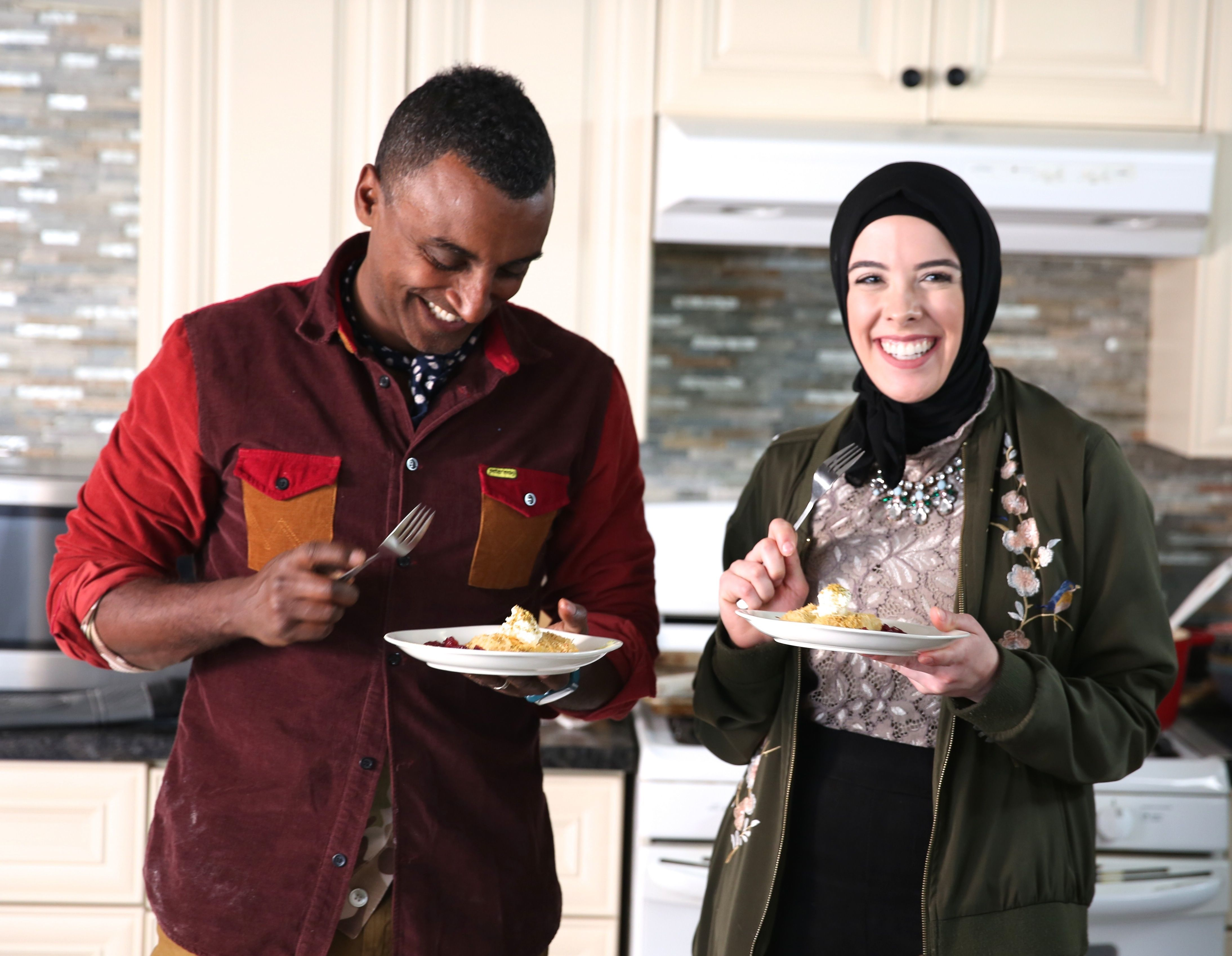 "Lena Sareini, right, with chef Marcus Samuelsson, host of PBS's ""No Passport Required."" Samuelsson visited Detroit in 2018  to explore local Middle Eastern food."