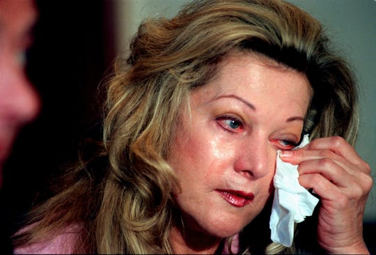 Kathleen Ford wipes tears from her eyes at a press conference Friday, Jan. 17, 1997 where her attorney, Frank Chopin, announced an increase to the $500,000 reward for the return of her stolen jewelry. Several dozen pieces of one-of-a-kind jewelry were stolen from the Palm Beach home of the widow of Henry Ford II last weekend.