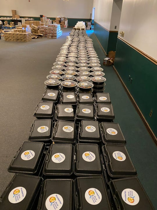 Hundreds of fresh meals, funded by World Central Kitchen and prepared by Detroit chefs, await distribution at Triumph Church in Detroit on May 1, 2020.