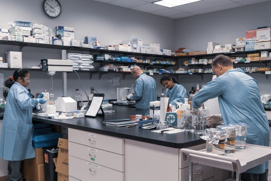 Scientists  work at BlueWillow Biologics in Ann Arbor, a firm that's now selling a nasal antiseptic that it says has been proven to fight COVID-19 in lab tests.