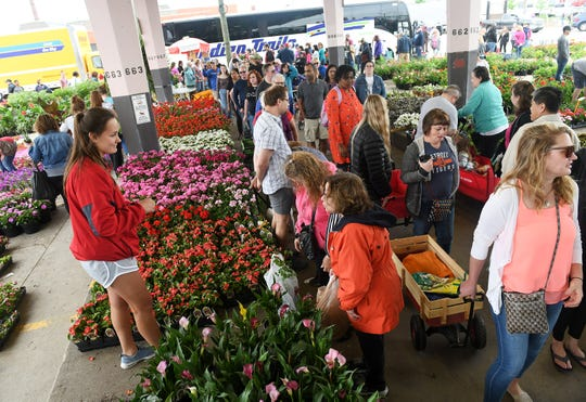 As many 100,000 people come to Eastern Market for the annual Flower Day.
