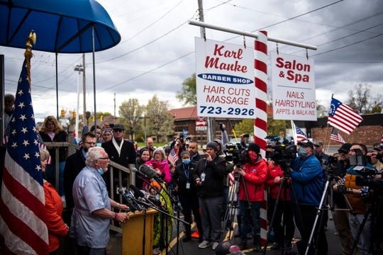 Karl Manke, 77, talks during a news conference outside of his barbershop at 421 West Main in Owosso, Monday afternoon, Manke opened his barbershop and has hired Kallman Legal Group as his legal counsel because he was charged with criminal misdemeanor violations for allegedly violating Gov. Gretchen Whitmer's executive orders.