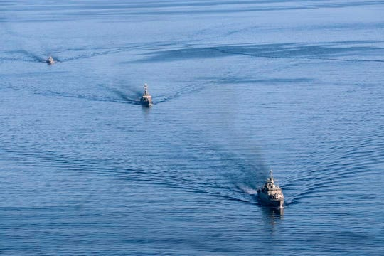 In this photo provided, Dec. 28, 2019, by the Iranian Army, warships sail in the Sea of Oman during the second day of joint Iran, Russia and China naval war games.