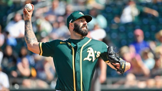 Oakland Athletics starting pitcher Mike Fiers went 15-4 with a 3.90 ERA last season.