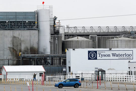 In this Friday, May 1, 2020, photo, a worker leaves the Tyson Foods plant in Waterloo, Iowa. The coronavirus is devastating the nation's meatpacking communities -- places like Waterloo and Sioux City in Iowa, Grand Island, Neb., and Worthington, Minn. Within weeks, the outbreaks around slaughterhouses have turned into full-scale disasters.