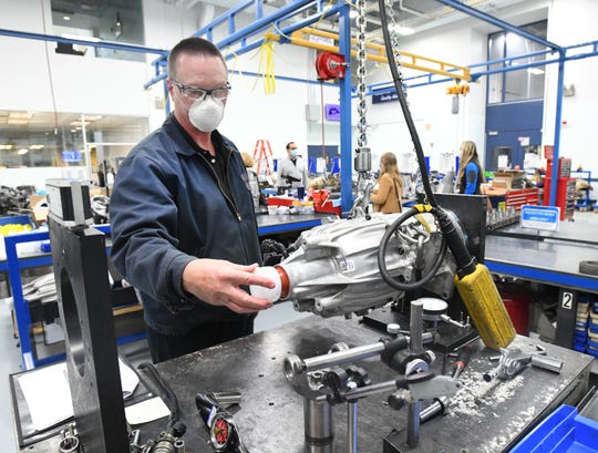 Technician Randy Ford works in the final measurement check area on a transfer case for a Ford vehicle at BorgWarner in Auburn Hills, Michigan on May 11, 2020.