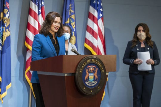 Michigan Gov. Gretchen Whitmer, left, speaks at a press conference on the state's COVID-19 response on Monday, May 11, 2020.