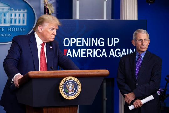 In this April 16, 2020, file photo, President Donald Trump speaks about the coronavirus, accompanied by Dr. Anthony Fauci in the James Brady Press Briefing Room of the White House in Washington.