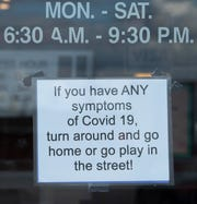 A sign on the door at the Merry-Go-Round Restaurant at 2101 N. Fares Avenue Monday evening, May 11, 2020. It was the first day the restaurant had been open for nearly two months due to the coronavirus pandemic.