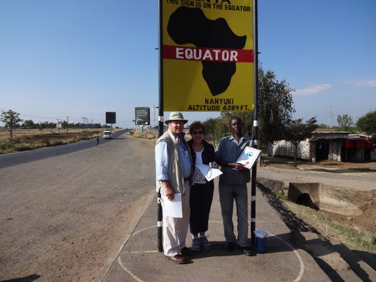 Standing on the Equator in Kenya.