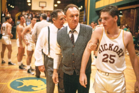 "Gene Hackman (center) plays the head coach of the Hickory Huskers in ""Hoosiers."""