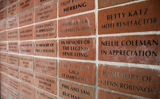 Bricks with names of volunteers and donors are on display at The Museum of The Islands in Bokeelia.The museum is housed in what was once the islandÕs first public library, and was built by volunteers in the early 1960s.