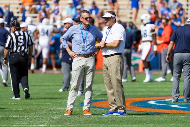 Florida Gators head coach Dan Mullen talks with Athletic Director Scott Stricklin during the game against the Auburn Tigers at Ben Hill Griffin Stadium in Gainesville, Florida, on Saturday, October 5, 2019.