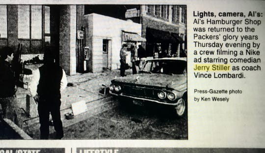 A 1996 newspaper clipping from the Green Bay Press-Gazette shows filming outside Al's Hamburger Shop on Washington Street for a Nike commercial starring Jerry Stiller as Vince Lombardi.