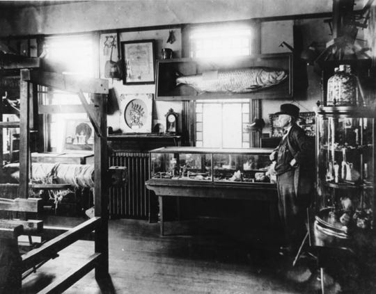 Rowell's greatest love may have been his many collections of minerals and relics of the past; his pride was certainly in the museum where they were displayed. In this photograph, taken about 1918, he posed in front of the displays at the then YMCA. Most of the collection was destroyed by a fire in 1942, but some parts of it had been loaned to the Charleston Museum, where they remain.