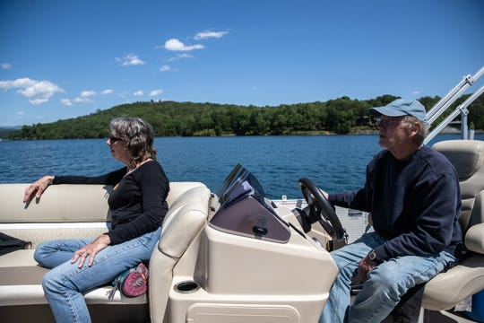 Kay and Brooks Wade, owners of Jocassee Lake Tours, out on their boat on Lake Jocassee, Thursday, May 7, 2020.