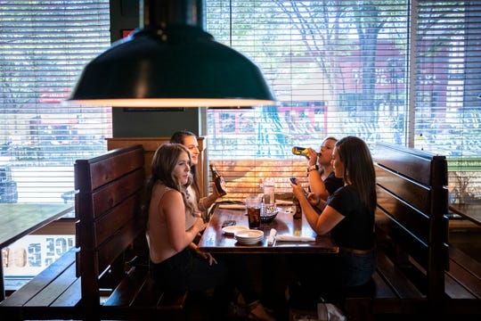 Anna Everhart, of Gafney, has lunch with her friends Caroline Gragg, Jessica Gardner, and Lindsey Rector at Sticky Fingers Ribhouse on Main Street in Greenville, Monday, May 11, 2020.