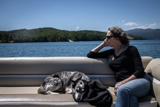 Kay Wade, owner of Jocassee Lake Tours with her husband Brooks Wade, out on their boat on Lake Jocassee, Thursday, May 7, 2020.