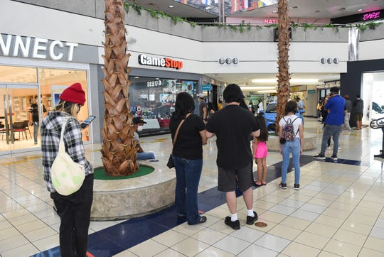 A long line of GameStop customers forms during the Micronesia Mall's reopening in Dededo on May 11, 2020.