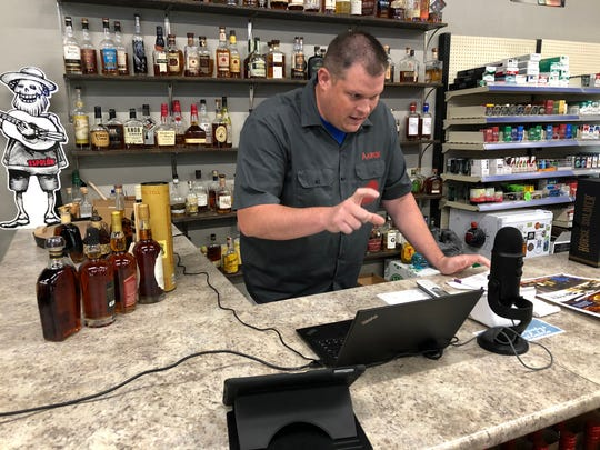 Aaron Nelson of Henderson's Beverage Barn gets started last Friday with the liquor store's weekly online raffles in which participants whose names are drawn have a chance to purchase one of several bottles of bourbon or rye that are often hard to find on store shelves. Since in-person raffles had to be halted in March because of the coronavirus pandemic, the virtual raffle has attracted viewers from across the country.