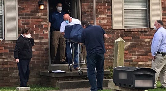 The Henderson County Coroner's Office removes two bodies from a Peggy Drive residence Monday afternoon (May 11, 2020).
