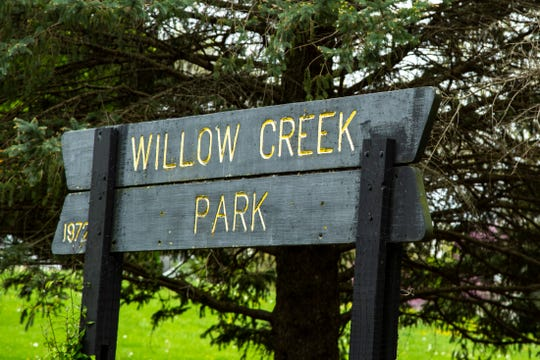 A sign at Willow Creek Park is seen, Monday, May 11, 2020, in Iowa City, Iowa.