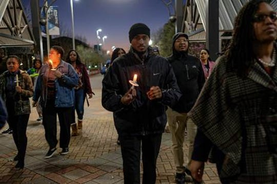 Markus Brooks, foreground, joins a candlelight vigil at Jackson State University in Jackson, Miss., on Feb. 27, 2020. The event was part of several planned to commemorate the 50th anniversary of the May 15, 1970, shooting at what was then Jackson State College. Twelve were injured and two were killed, Phillip Lafayette Gibbs, a Jackson State prelaw major, and James Earl Green, a local high school student, during a shooting by law enforcement. The senior aims to become a lawyer, the same dream held by Gibbs.