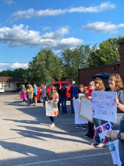 Families gathered in the parking lot of Westover Elementary to celebrate with Elise Eads for finishing her chemotherapy.