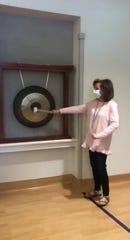 Elise Eads rings the bell at Kirkland Cancer Center to celebrate finishing her chemotherapy on May 6, 2020.